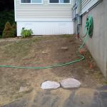 Before picture of retaining wall installed in Gilford New Hampshire, Belknap County