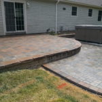 Raised Paver Patio Installed by Natures Elite Landscaping, Serving all of New Hampshire's Lakes Region and beyond.